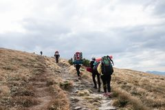Group tourism. Conquering the top of the mountain group of tourists royalty free stock photos
