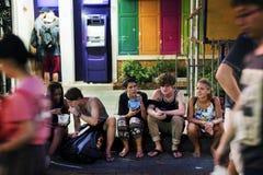 Group of tourist enjoy bucket drinks Bangkok Thailand walking street royalty free stock photography