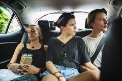 Group of tourist sitting in the taxi backseat doing sight seeing tour Stock Photos