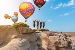 Group tourist on top Colorful hot-air balloons flying over the m stock photos