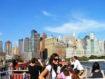 Group of tourists on the background of Manhattan, New York, USA. A group of tourists on a sightseeing boat admires the view of Manhattan on a clear autumn day stock images