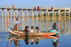 Group of tourists in a boat near U Bein Bridge, Amarapura, Myanm Stock Photo