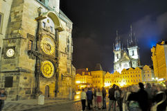 Group of tourists in center of Prague at night