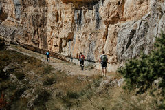 Group of tourists climbers walking trail Stock Image