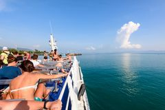 Group of tourists on the deck. SURAT THANI, THAILAND-APRIL 28, Group of tourists are resting on the deck during the travel by boat on the sea in summer arrive at royalty free stock photo