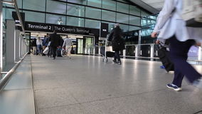 Group tourists entrance Heathrow airport London stock video footage