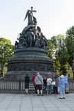 Group of tourists, a few people standing near the monument to th. Group of tourists, several people, men and women stand near the monument to the Millennium of Royalty Free Stock Image