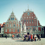 Group of tourists in front of House of the Blackheads - vintage effect. Stock Image