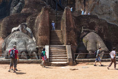 Group of tourists in front of Lion paw at Sigiriya complex Royalty Free Stock Photo