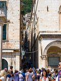 Group of tourists gathering in the old town of Dubrovnik. royalty free stock image