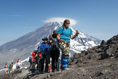 Group of tourists go hiking and climbing to the top of volcano Stock Photo
