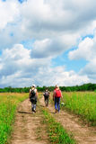 Group of tourists going in hikers walk Royalty Free Stock Image