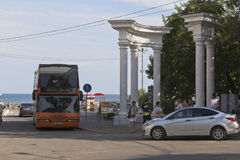 Group of tourists is going on a sightseeing trip on a double-decker bus-cabriolet `City Tour of Evpatoria`, Crimea Stock Image
