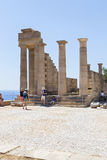 A group of tourists at the great colonnade of the Hellenistic portico Royalty Free Stock Images