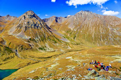 Group of hiking tourists on a mountain pass Stock Photo
