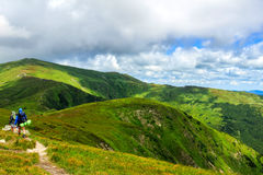 Group of tourists hiking in Carpathian mountains, nature landscape, Chornogora ridge, Ukraine. Royalty Free Stock Photography
