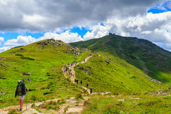 Group of tourists hiking in Carpathian mountains, nature landscape, Chornogora ridge, Ukraine. Stock Photo