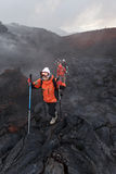 Group of tourists hiking on the new lava field eruption Tolbachik Volcano on Kamchatka. Russia, Far East Stock Photo