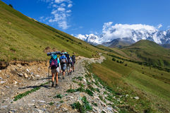 Group of tourists with large backpacks are on mountain Royalty Free Stock Photos