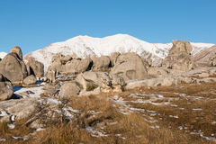 Group of tourists between limestone boulders in high country Royalty Free Stock Image