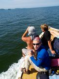 Group of tourists on motorboat. Sea landscape with group of tourists resting on motorboat with backpacks Royalty Free Stock Images