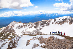A group of hiking tourists in the mountains Royalty Free Stock Photography