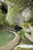 Group of tourists in the national park Plitvice Lakes, Croatia, Europe. Royalty Free Stock Photography