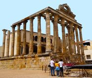 Temple of Diana, Mérida, Spain. A group of tourists observing the Famous Temple of Diana, situated in Mérida. Mérida is a UNESCO World Heritage city, situated Royalty Free Stock Images
