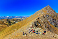 Group of hiking tourists on the pass Stock Image
