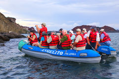 Group of tourists photographing from a dinghy near Bartolome isl Stock Images