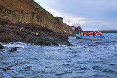 Group of tourists photographing from a dinghy near Bartolome isl Royalty Free Stock Photos
