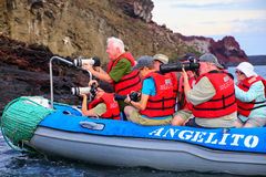 Group of tourists photographing from a dinghy near Bartolome isl Stock Photos