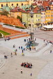 Group of tourists posing for a photo on Castle square in Warsaw Stock Photo