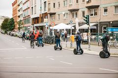 Berlin, October 3, 2017: Group of tourists riding on gyroscooters along the streets of Berlin during excursion. Group of tourists riding on gyroscooters along Royalty Free Stock Photography