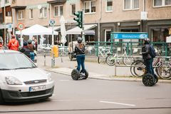 Berlin, October 3, 2017: Group of tourists riding on gyroscooters along the streets of Berlin during excursion. The car. Group of tourists riding on gyroscooters Stock Image