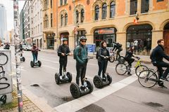 Berlin, October 3, 2017: Group of tourists riding on gyroscooters along the streets of Berlin during excursion. Cyclists. Group of tourists riding on Royalty Free Stock Image
