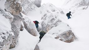 A group of tourists rises to the top of a snow-covered mountain. stock footage