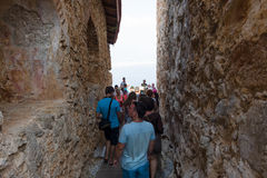Group of tourists in the ruins of the fortress of Alanya. Royalty Free Stock Photo