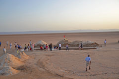 Group of tourists in a salty lake in the Sahara stock photography