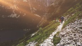 Group of tourists trekking in High Tatra mountains stock video