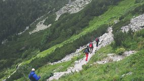Group of tourists trekking in High Tatra mountains. Vysoke Tatry, Slovakia. People walking by stone trail over the precipice. Beauty world, sport lifestyle stock video