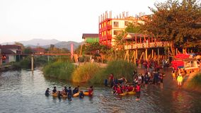 Group of Tourists Tubing in Vang Vieng. A group of tourists tubing in Vang Vieng, Laos stock footage