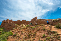 A group of tourists up the hill in the canyon Fairy Tale, Kyrgyz Royalty Free Stock Image