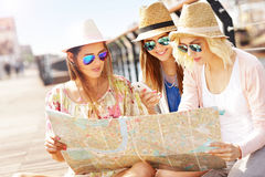 Group of tourists using map in the city Stock Image