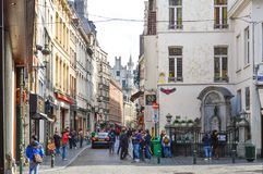Group of tourists visiting Manneken Pis or Little Man Pee located near Grand Place in the city of Brussels, Belgium stock image