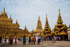 Group of tourists visting to Shwezigon pagoda. Royalty Free Stock Photo
