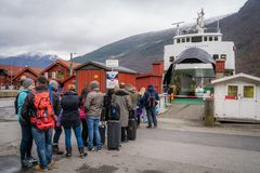 Tourists waiting for the fiord cruise. Group of tourists waiting for the Norway in a nutshell sightseeing cruise through the magnificent Aurlandsfjord and the Royalty Free Stock Photography