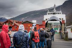 Tourists waiting for the fiord cruise. Group of tourists waiting for the Norway in a nutshell sightseeing cruise through the magnificent Aurlandsfjord and the Royalty Free Stock Images