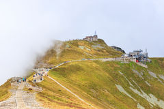 Group of tourists walk to the top of the Kasprowy Wierch in Tatra Mountains Royalty Free Stock Images