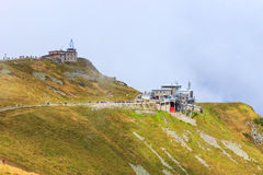 Group of tourists walk to the top of the Kasprowy Wierch in Tatra Mountains Stock Images